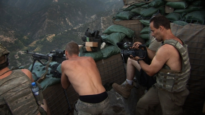 Korengal-Sebastian-Junger-Filming-During-a-Firefight